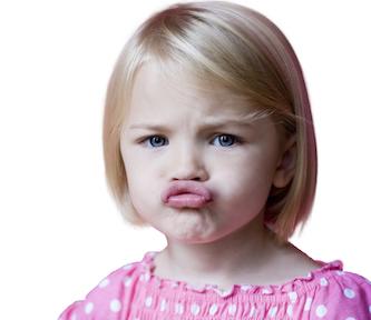Girl (4-5) pouting, portrait